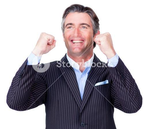 Attractive businessman punching the air