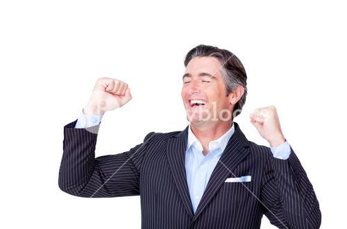 Mature businessman punching the air