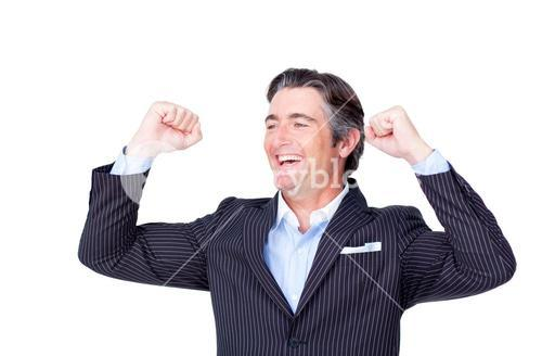 Businessman punching the air