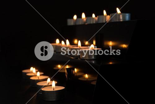 Candles at the alter in the darkness