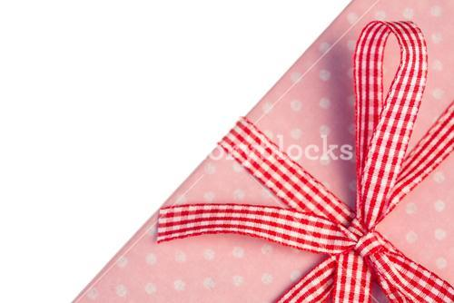 Pink gift wrapped present with gingham ribbon
