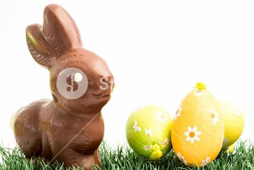 Chocolate bunny rabbit and three easter eggs