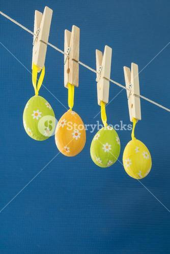 Easter eggs hanging from a washing line