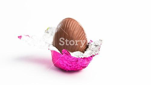 Easter egg unwrapped in pink foil