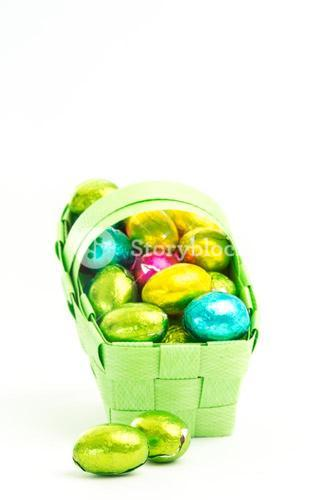 Foil wrapped easter eggs in a basket