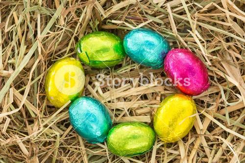 Easter eggs in a circle on straw