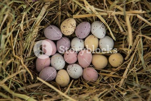 Little candy easter eggs in straw