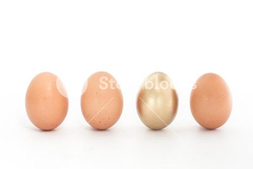 Four eggs in a row with one gold one