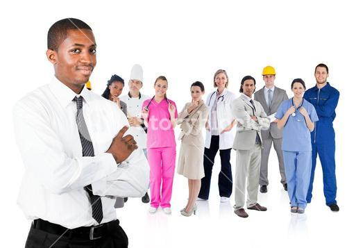 Businessman in shirt standing in front of different types of workers