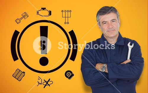 Mature mechanic standing next to car warning signals