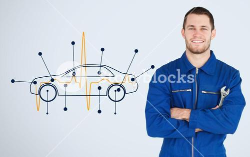 Portrait of a young mechanic next to background with car