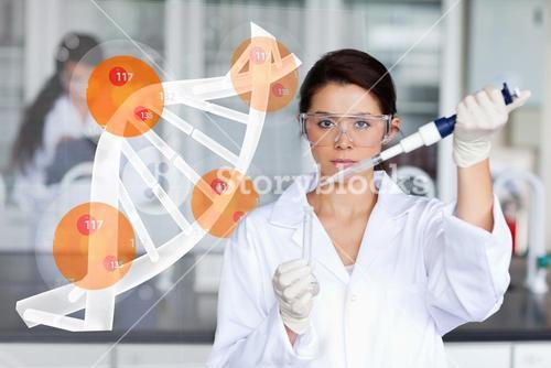 Pretty lab worker adding chemical to test tube