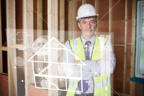 Architect standing behind white house plan interface