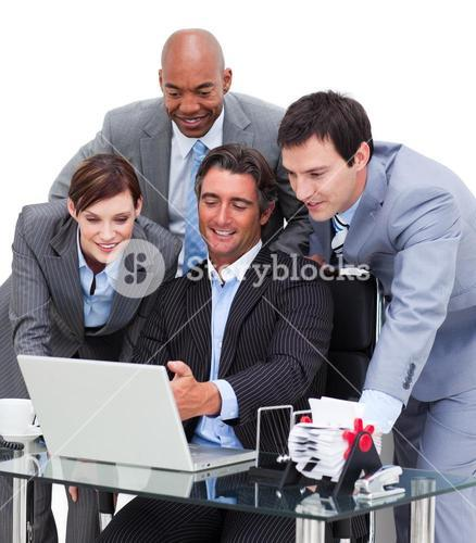 Multicultural business team working at a computer
