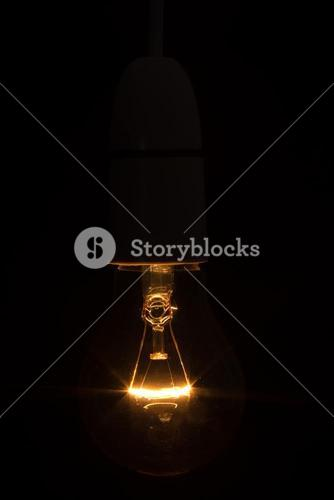 Close up of bright light bulb in the dark