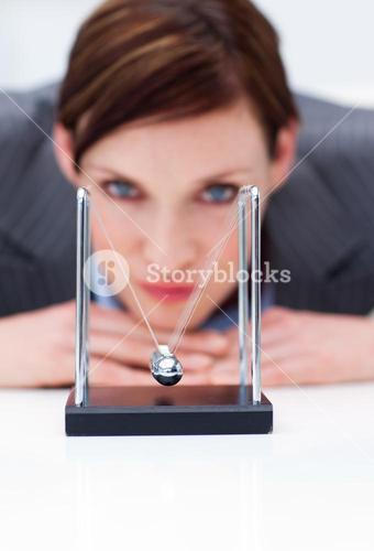 Businesswoman playing with kinetic balls