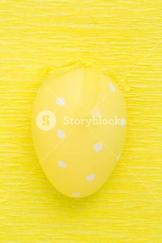 Close up on yellow easter egg