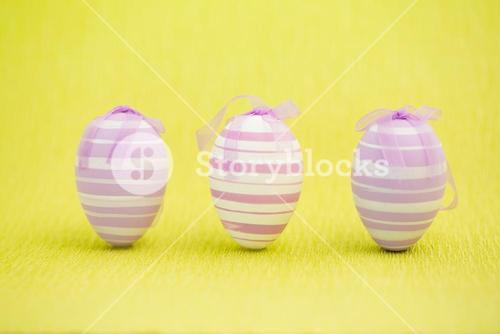 Purple easter eggs standing