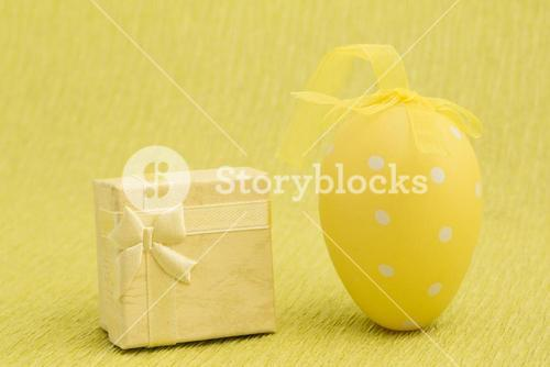Yellow easter egg and present