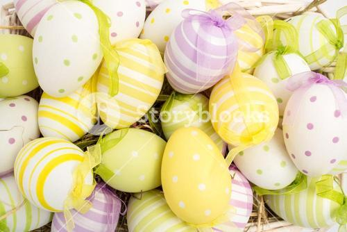 Colourful easter eggs in straw