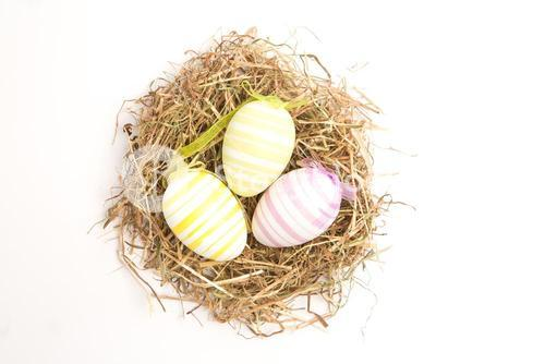 Three striped easter eggs in straw