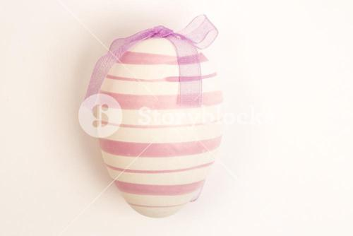 Purple easter egg with ribbon