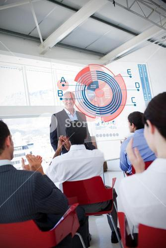 Business people clapping stakeholder standing in front of diagram interface