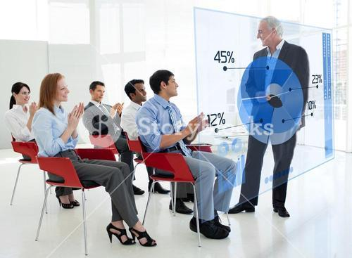 Business people clapping stakeholder standing in front of blue pie chart interface