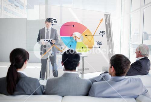 Business people listening and looking at colorful pie chart interface