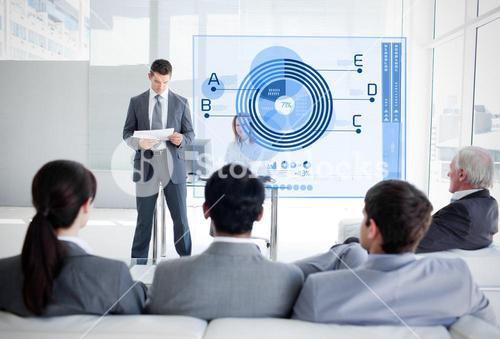 Business people listening and looking at blue diagram interface