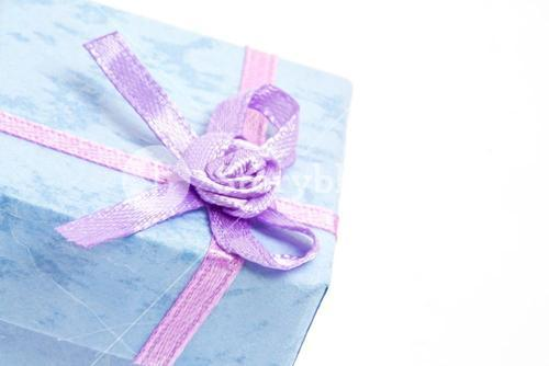Close up of blue gift box with purple ribbon