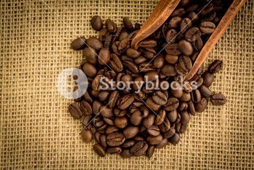 Wooden shovel with coffee beans