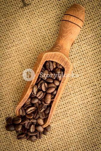 Wooden shovel of coffee beans