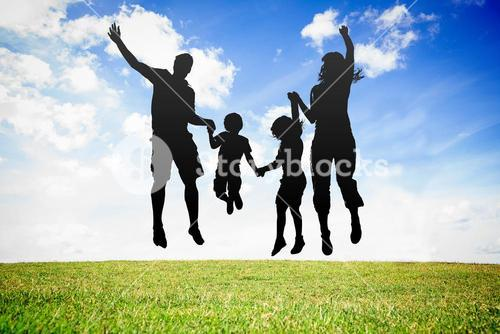 Silhouette of jumping family
