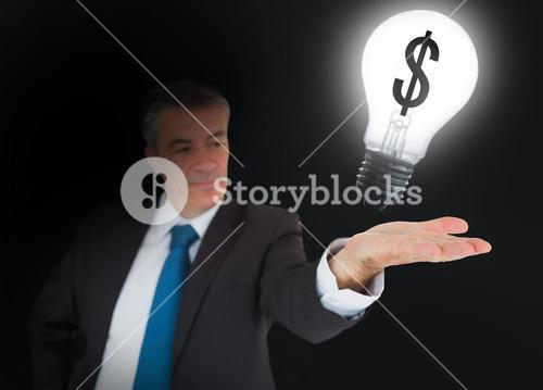 Businessman showing light bulb
