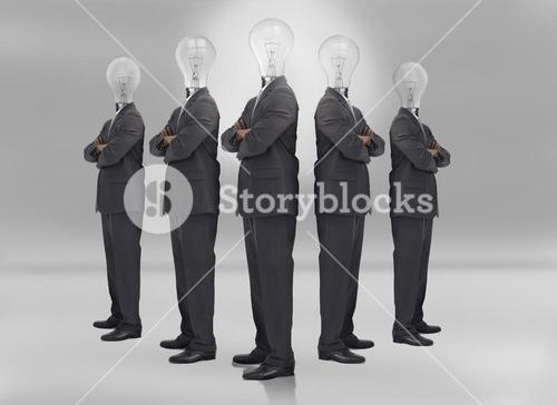 Businessman with bulb head on grey background