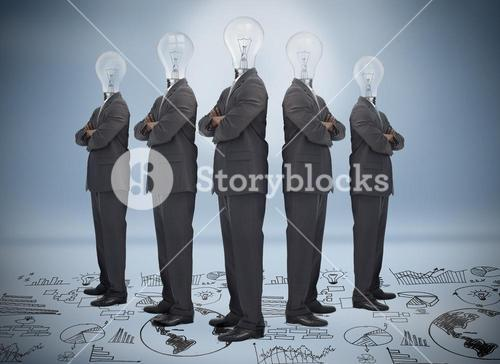 Businessman with bulb head multiplied standing on floor of graphs
