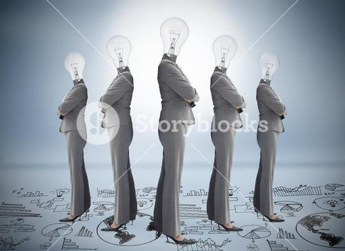 Businesswoman with bulb head multiplied standing on floor of graphs