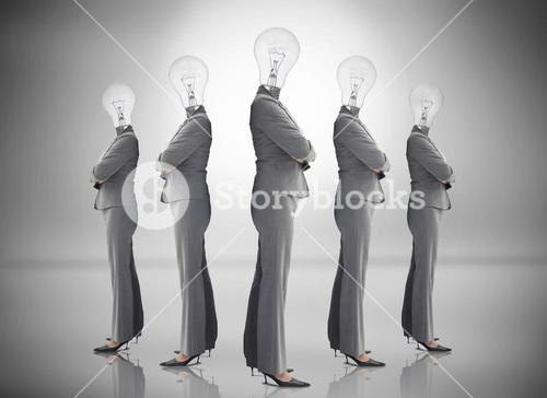 Buinesswoman with bulb head multiplied on grey background