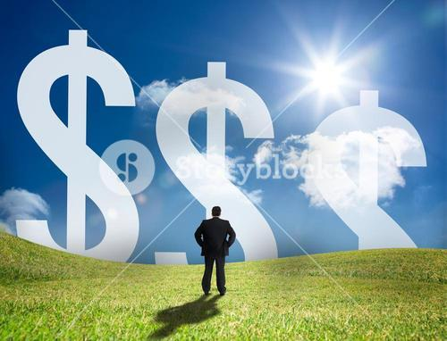 Businessman looking at large dollar signs on the horizon