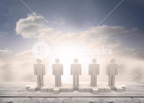 Human figures standing in line on jigsaw pieces