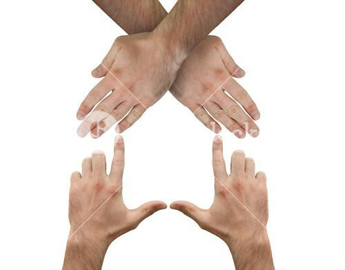 Hands crossed representing a house