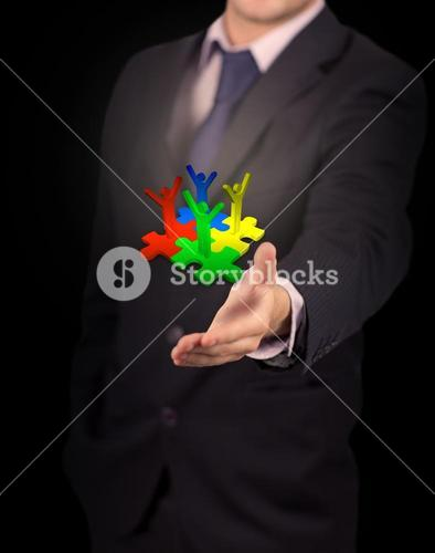 Businessman presenting human forms with raised arms