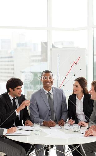 Manager in a meeting with his team
