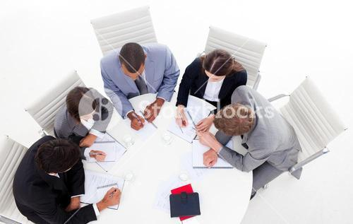 High angle of a diverse business group sitting around a conference table