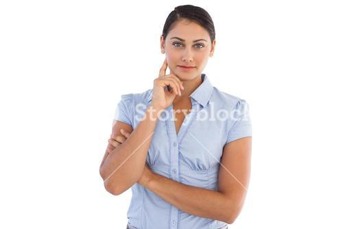 Businesswoman standing alone with her hand to her face