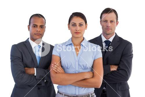 Group of serious business people standing together