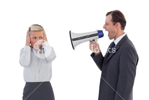 Businessman shouting at colleague with his bullhorn