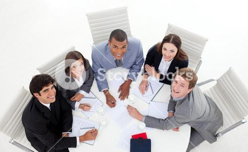 High angle of business people smiling at the camera