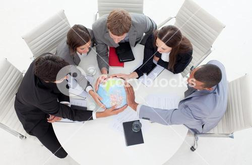 High angle of a business people holding a terrestrial globe